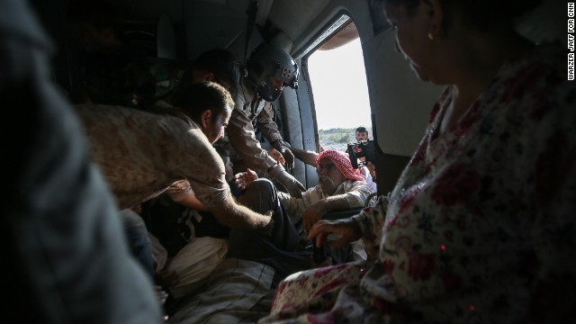 """A couple dozen civilians were rescued during the operation. CNN's Ivan Watson, who was on the chopper, described the mission as """"heroic."""""""