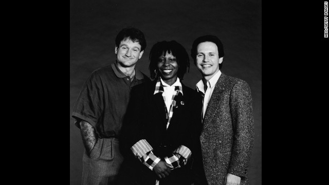 "Robin Williams was honored during this year's Emmy telecast with a tribute led by friend Billy Crystal, who hosted the ""Comic Relief"" benefits with Williams and Whoopi Goldberg (seen here in 1986). Williams died August 11 at age 63. Click through to see moments from the beloved actor's remarkable life."