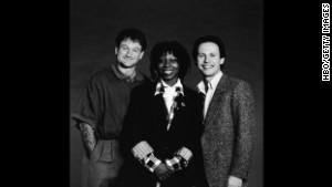 Promotional studio portrait of American comedians and Robin Williams, Whoopi Goldberg and Billy Crystal, the hosts of the 'Comedy Relief' variety benefit special, in 1986.