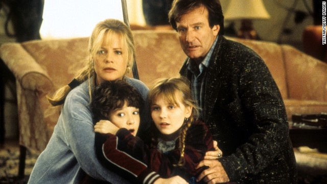 From left, Bonnie Hunt, Bradley Pierce, Kirsten Dunst and Williams hold one another in