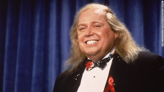 """A rare glimpse of the comic out of his trademark duster and beret, shrieking Sam Kinison attends the Emmy Awards in 1991, a year before his untimely death at 38 from a head-on collision. Kinison -- who admitted to struggling with drugs, alcohol and his weight -- rose to mainstream fame in Rodney Dangerfield's """"Back to School"""" and appearances on """"Late Night with David Letterman"""" and """"SNL."""" He also had his own HBO special, 1987's """"Breaking the Rules."""""""