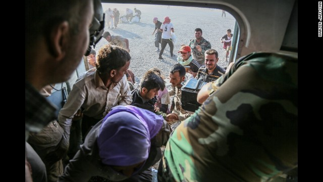 "IRAQ: A couple dozen civilians were rescued during the operation. CNN's Ivan Watson, who was on the chopper, described the mission as ""heroic."" A CNN team along with the Iraqi air force and fighters with the Kurdish peshmerga carried out a dramatic rescue mission Monday at Mount Sinjar, taking supplies to desperate Yazidis and ferrying a handful of people out. Photo by Warzer Jaff for CNN, August 11. <a href='http://www.cnn.com/2014/08/11/world/meast/iraq-rescue-mission/'>FULL STORY AT CNN.COM</a>."