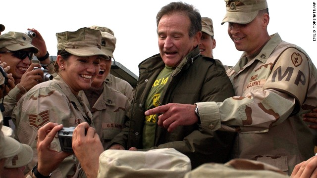 Williams poses for pictures with U.S. soldiers at the main U.S. base at Bagram, Afghanistan, on December 16, 2004.