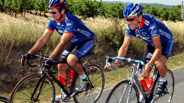 U.S. Postal Service team rider Lance Armstrong rides with Williams during training on a rest day of the 89th Tour de France cycling race in Vaison La Romaine on July 22, 2002.
