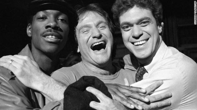 "Williams, center, takes time out from rehearsal at NBC's ""Saturday Night Live"" with cast members Eddie Murphy, left, and Joe Piscopo on February 10, 1984. Williams would appear as guest host on the show."