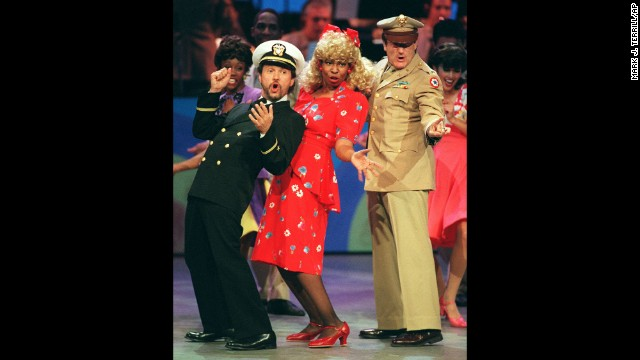 "Comedians and co-hosts, from left, Billy Crystal, Whoopi Goldberg and Williams sing and dance the 1940s-era opening number to ""Comic Relief V"
