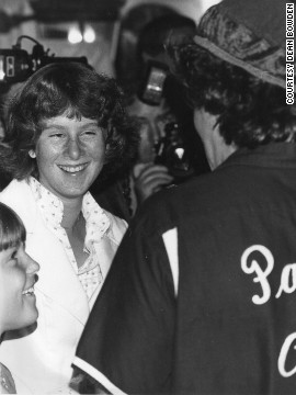 "While at a press event in 1978, <a href='http://ireport.cnn.com/docs/DOC-1161293'>Dean Bowden</a> watched as Williams broke through the line to autograph fans' memorabilia. ""I have an extra squiggly mark on my autograph book because it was upside down at first,"" he said. Williams is in the foreground on the right in this photo."