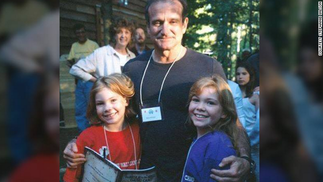 "At age 9, <a href='http://ireport.cnn.com/docs/DOC-1161134'>Stephanie Wilson</a>, left, met Robin Williams while at a camp for sick children. In 1999, she got to perform with the comedian at a fundraising gala. ""He was hilarious. I wish he had known how much we appreciated him,"" she said."