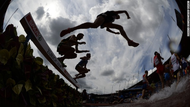 AUGUST 12 - ZURICH, SWITZERLAND: Athletes compete in the men's 3000 meter steeplechase heats at the European Athletics Championships at the Letzigrund stadium. The event will host <a href='http://www.zuerich2014.ch/en/group-1/event/facts-and-figures' target='_blank'>around 1400 athletes from 50 countries</a> and will last for six days.