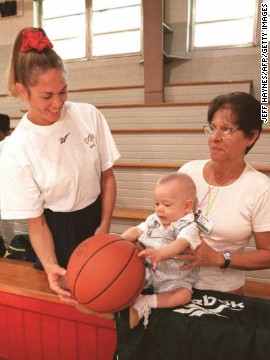 Hortencia played in the Atlanta Games despite giving birth to Joao just five months earlier. Then 36, she is pictured introducing baby Joao (and his nanny) to basketball during a training session ahead of the 1996 Olympics.