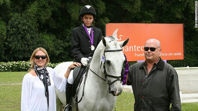 Fast forward more than a decade, and Joao -- 14 in this photo -- is pictured with his mother and father (businessman and horse breeder Jose Victor Oliva). Joao says he has his mother's sporting nature, but inherited his father's passion for horses.