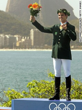 Pessoa won the Athens 2004 Olympic showjumping title, but only once Irish rider Cian O'Connor had been disqualified -- months after the event -- following the revelation that his horse had tested positive for a prohibited substance. Here Pessoa receives the gold medal, at last, a year later in front of Rio's Sugarloaf Mountain.