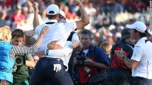 The German was swamped by his jubilant teammates, with Rory McIlroy on his right joining the celebrations.