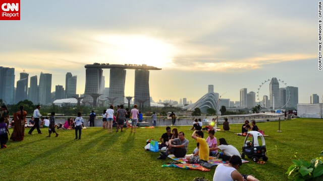 A bright sunset sneaks through the wispy clouds hanging over Singapore's <a href='http://ireport.cnn.com/docs/DOC-799773'>Marina Barrage</a>, a dam at the heart of the city that stretches over the mouth of the Marina Channel.