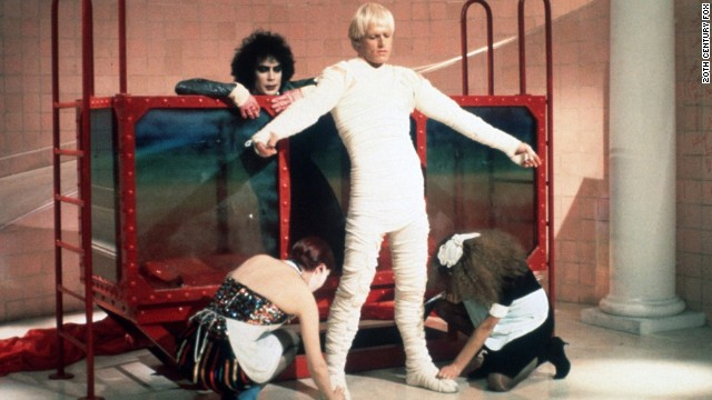 "Peter Hinwood, the man who famously wore those teensy gold shorts (under his mummy wrap here) as Dr. Frank N Furter's creation, Rocky, has since receded from the spotlight. After his star turn in ""The Rocky Horror Picture Show,"" the former actor was credited for one other film before he dropped the pursuit. Now an art and antiques dealer in London, <a href='http://www.people.com/people/archive/article/0,,20132607,00.html' target='_blank'>he told People magazine</a> in 2000 that he left acting behind because ""One, I can't act. Two, I cringe with embarrassment every time I see myself on film. (And) three, I relish a quiet, peaceful life."""