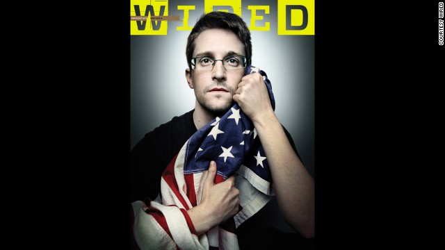 Wired magazine has published a cover photo of NSA leaker Edward Snowden holding the American flag in both of his hands, as if protecting it from the government. Click through the gallery to look at some other controversial magazine covers through the years: