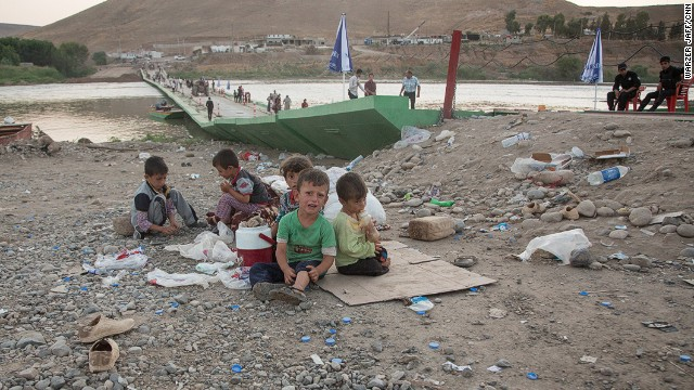 Children rest after arriving back into Kurdish-controlled Iraq.