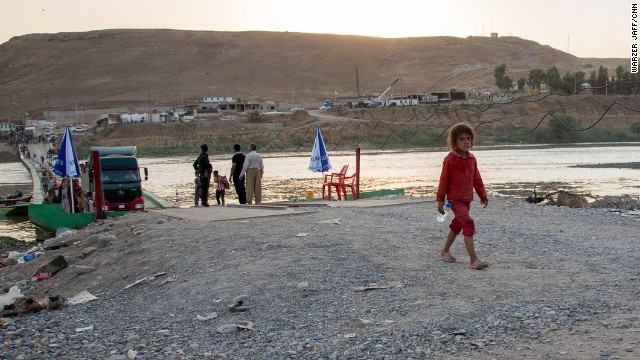 A little girl was seen crossing the bridge by herself. The United States is sending more troops to northern Iraq, a move that U.S. officials told CNN is necessary to help in the rescue of tens of thousands of Yazidis trapped in the mountains.