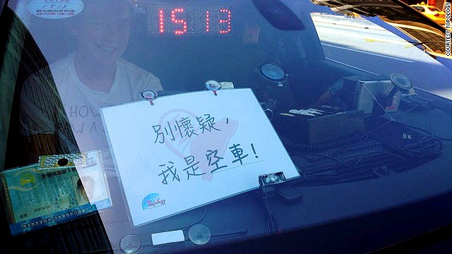 "Taxi Diary works with five English-speaking taxi drivers. Signs explaining the project allow potential passengers to decide if they want to participate before they hire the cab. This sign says: ""Don't doubt it. I'm an empty cab."""