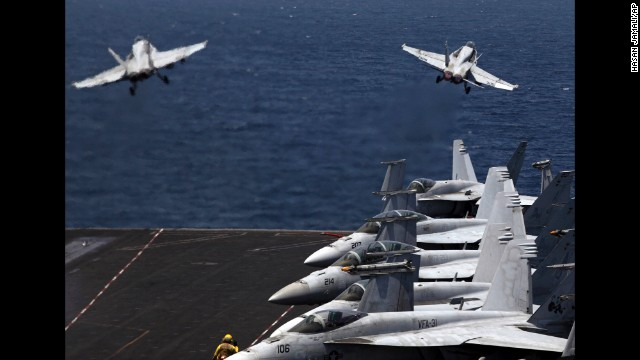 From the flight deck of the USS George H.W. Bush, which is in the Persian Gulf, two U.S. fighter jets take off for a mission in Iraq on Monday, August 11. U.S. President Barack Obama has authorized airstrikes against Islamic militants and food drops for Iraqis who are trapped by the militants.