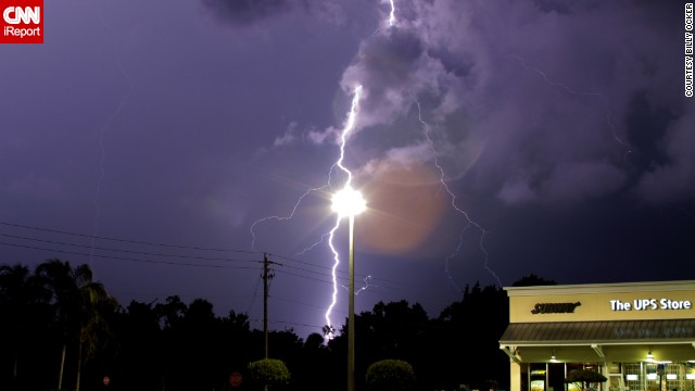 "It's only an optical illusion, but lightning appears to be striking a lamppost in this June photo from <a href='http://ireport.cnn.com/docs/DOC-1141887'>Billy Ocker</a>. ""The storm was wicked strong,"" he remembered."