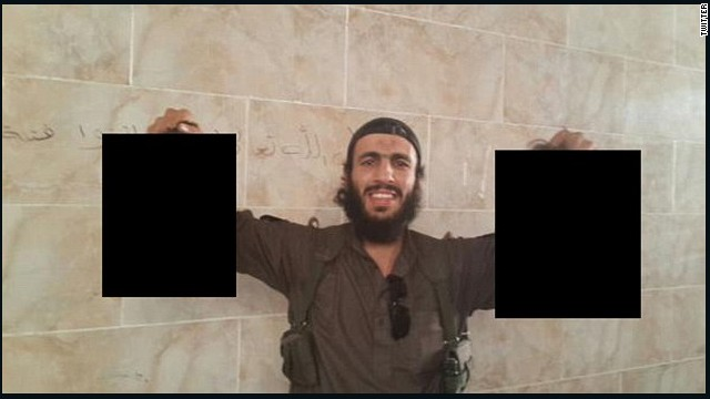 An image believed to be of Mohamed Elomar holding severed heads posted to Twitter.