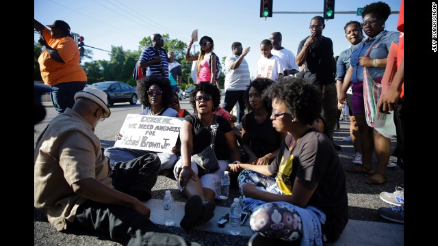 A small group of protesters block traffic in the street before police arrived on August 13.