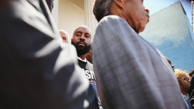 Michael Brown Sr. stands alongside Sharpton, right, during a news conference in St. Louis on August 12.