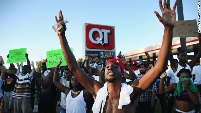 Demonstrators protest August 12 in Ferguson.