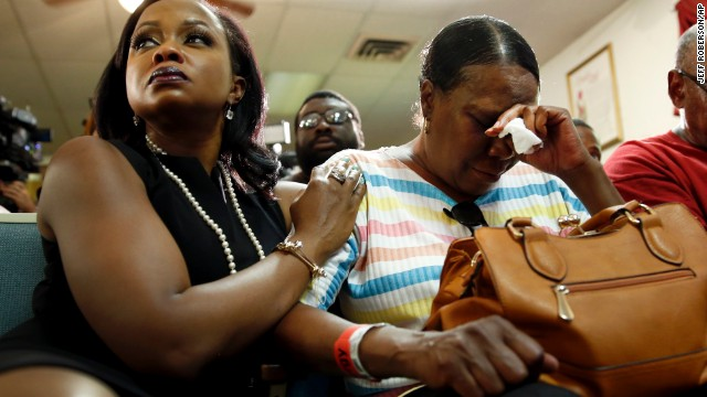 Phaedra Parks, left, comforts Desuirea Harris, the grandmother of Michael Brown, during a news conference in Jennings, Missouri, on August 11.