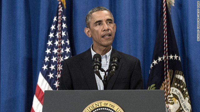 Obama on hiatus from vacation with Iraq, Ferguson on his agenda