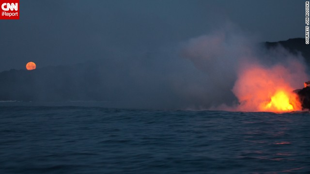 <a href='http://ireport.cnn.com/docs/DOC-967646'>Jon Rosiska</a> photographed lava flowing into the ocean while traveling along the Big Island's coastline in April 2013.