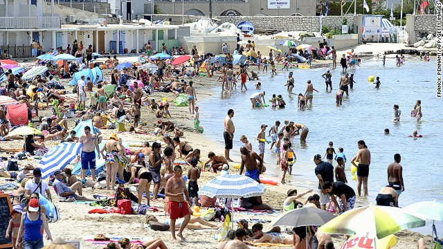 "The French city of Marseille is named the world's fifth least friendly by readers of Conde Nast Traveler. It has ""cool street art,"" the survey says, but uncool crime levels. Crowded beaches, such those at Pointe Rouge (pictured), can perhaps lead to some people getting a little testy."