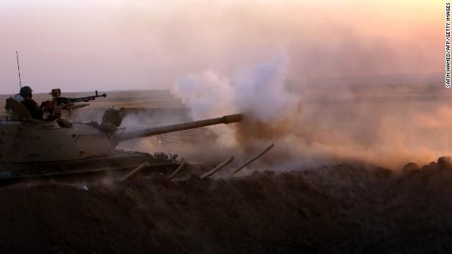 Kurdish Peshmerga fighters fire at ISIS in Khazair, Iraq, on Thursday, August 14.