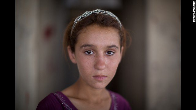 ZAKHO, IRAQ: Aziza Hamid, 15, was rescued from Mount Sinjar and now lives in a derelict building that houses more than a thousand other refugees. Her face and her sisters, 17-year-old Dunya stood out in the chaotic helicopter evacuation off the Sinjar Mountains. Two days later, CNN's Ivan Watson tracked the girls and some of their family members to a makeshift shelter. <a href='http://edition.cnn.com/2014/08/13/world/meast/iraq-after-isis-escape/index.html?hpt=hp_t1'>FULL STORY AT CNN.COM</a>. Photo by Warzer Jaff for CNN.