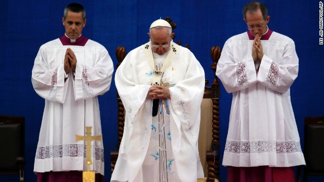 Pope Francis prays during the Mass of the Assumption of Mary on August 15.