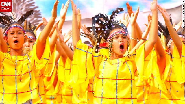 "Children perform at the colorful <a href='http://ireport.cnn.com/docs/DOC-1022978'>Kadayawan Festival</a> in Davao City in the Philippines in August 2013. The event, known as the ""King of Festivals"" for its grandness, celebrates the season's harvest."