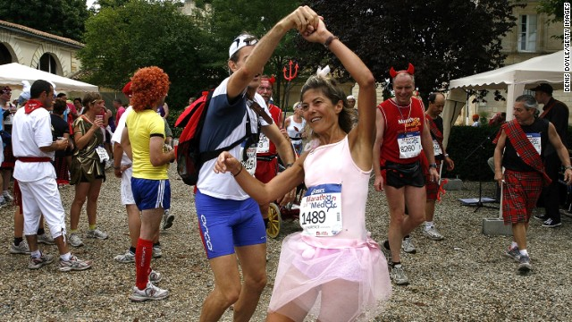 Impromptu dance breaks are an essential part of the race for many taking part in the Medoc Marathon.