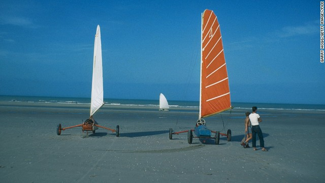 Landsailing isn't just restricted to deserts. Here, enthusiasts test out their designs on a European beach in the 1970s.