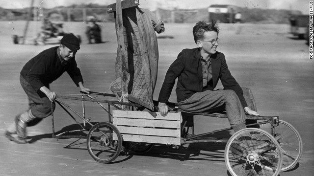Here British youngsters in the 1950s go for a spin in their makeshift vehicle -- an old pram with a raincoat for a sail.