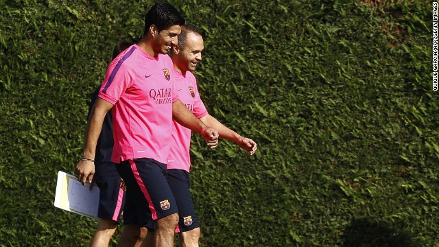 "Luis Suarez has completed his first training session with his Barcelona teammates. The Uruguayan lost his appeal to have his four-month ""biting ban"" reduced by the Court of Arbitration for Sport on Thursday but the restriction on him training with his new teammates was lifted. The former Liverpool player, seen here with Andreas Iniesta, cannot play competitive football for Barcelona until the end of October."