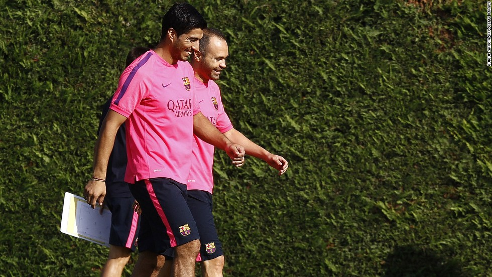 "Luis Suarez has completed his first training session with his Barcelona teammates. The Uruguayan lost his appeal to have his four-month ""biting ban"" reduced by the <a href='http://cnn.com/2014/08/14/sport/football/luis-suarez-biting-ban-cas-barcelona/index.html'>Court of Arbitration for Sport</a> on Thursday but the restriction on him training with his new teammates was lifted. The former Liverpool player, seen here with Andreas Iniesta, cannot play competitive football for Barcelona until the end of October."