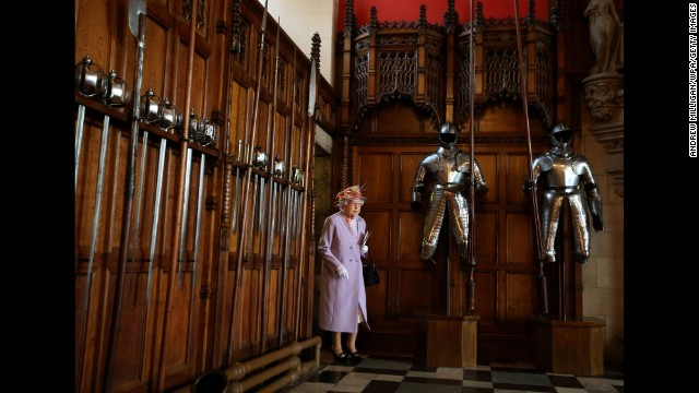 The Queen enters the Great Hall at Edinburgh Castle after attending a commemorative service for the Scottish National War Memorial on July 3.