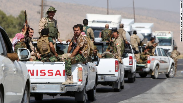 Trucks carrying Kurdish Peshmerga fighters head to the Mosul Dam on August 17.