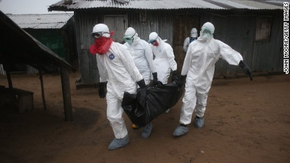 A Liberian burial team wearing protective clothing retrieves the body of a 60-year-old Ebola victim from his home on August 17, 2014 near Monrovia, Liberia.
