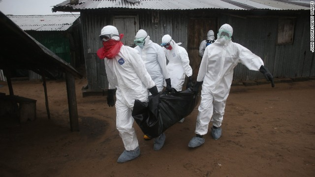 A burial team wearing protective clothing retrieves the body of a 60-year-old Ebola victim from his home near Monrovia on Sunday, August 17.