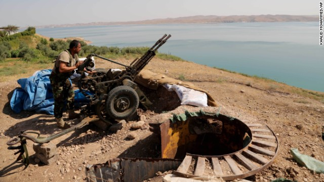 A Kurdish Peshmerga fighter prepares his weapon on August 17 at a combat position near the Mosul dam in Chamibarakat.