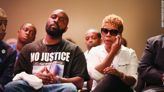 Michael Brown Sr. and Lesley McSpadden, the parents of Michael Brown, attend a rally at Greater Grace Church in Ferguson on August 17.