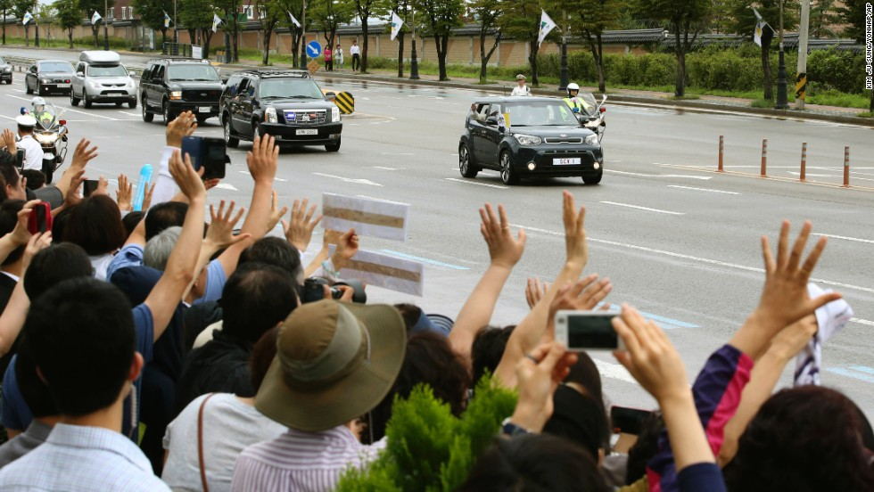 Pope Francis waves to crowds from inside a vehicle near Seoul Air Base in Seongnam on Monday, August 18. The Pope's trip to South Korea marks the first papal visit to the country since Pope John Paul II went there 25 years ago.