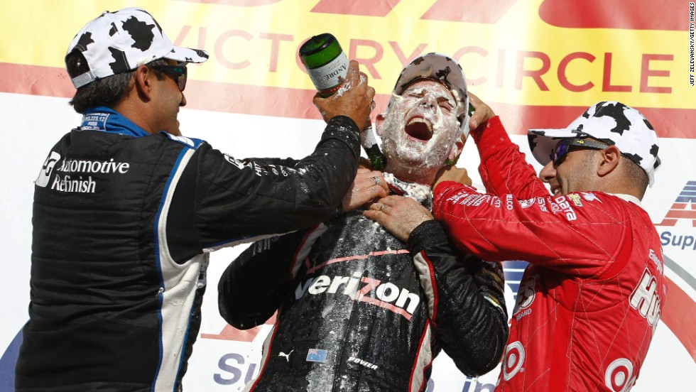 IndyCar drivers Tony Kanaan, right, and Juan Pablo Montoya, left, celebrate with Will Power after Power won at the Milwaukee Mile racetrack Sunday, August 17, in West Allis, Wisconsin. Kanaan and Montoya hit Power with <a href='http://www.wistatefair.com/wp/original-cream-puffs/' target='_blank'>cream puffs</a> — a popular staple of the Wisconsin State Fair.